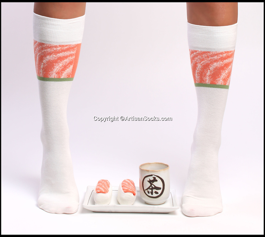 BNPS.co.uk (01202 558833)<br /> Pic: ArtisanSocks/BNPS<br /> <br /> ***Must Use Full Byline***<br /> <br /> Salmon sushi socks.<br /> <br /> Soft Sushi Shuffle...<br /> <br /> Octopus Tako sushi socks being worn and rolled up. <br /> <br /> Now, should you wish to, you can make your sock draw look like a sushi bar.<br /> <br /> These morsels of mouthwatering sushi might look tantalising but you wouldn't want to eat them - because they're actually rolled up socks.<br /> <br /> The super-realistic items of clothing are the latest bizarre trend sweeping the fashion world and have been an instant hit with shoppers.<br /> <br /> Unrolled they look like any other sock but rolled up they form seven different varieties of the raw fish snack, transforming your underwear drawer into a smorgasbord of sushi.<br /> <br /> The life-like 'flavours' include egg (tamago), salmon roe (ikura), shrimp (ebi), octopus (tako), tuna (maguro ), salmon (sa-mon) and trout (masuzishi).<br /> <br /> Sushi socks cost $6 a pair - around £3.70 - and can be bought from artisansocks.com.