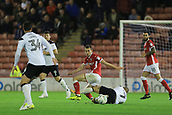 12th September 2017, Oakwell, Barnsley, England; Carabao Cup, second round, Barnsley versus Derby County; Joe Williams of Barnsley FC beats Johnny Russell of Derby County to the ball