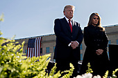 United States President Donald J. Trump, left, and first lady Melania Trump pause during a ceremony to commemorate the September 11, 2001 terrorist attacks, at the Pentagon in Washington, D.C., U.S., on Monday, Sept. 11, 2017. Trump is presiding over his first 9/11 commemoration on the 16th anniversary of the terrorist attacks that killed nearly 3,000 people when hijackers flew commercial airplanes into New York's World Trade Center, the Pentagon and a field near Shanksville, Pennsylvania. <br /> Credit: Andrew Harrer / Pool via CNP