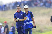 Rory McIlroy Team Europe and Harry Diamond on the 9th green during Friday's Fourball Matches at the 2018 Ryder Cup, Le Golf National, Iles-de-France, France. 28/09/2018.<br /> Picture Eoin Clarke / Golffile.ie<br /> <br /> All photo usage must carry mandatory copyright credit (© Golffile | Eoin Clarke)