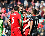 Fraser Forster of Southampton hugs James Milner of Liverpool during the English Premier League match at Anfield Stadium, Liverpool. Picture date: May 7th 2017. Pic credit should read: Simon Bellis/Sportimage