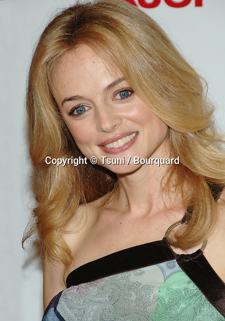 Heather Graham arriving at the BOBBY  Premiere at the Chinese  Theatre in Los Angeles.<br /> <br /> headshot<br /> smile<br /> eye contact