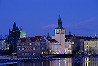 City lights reflect in the VLTAVA RIVER in historic PRAGUE - CZECH REPUBLIC