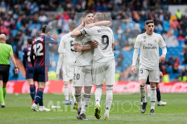 Real Madrid's Marco Asensio (L) and Karim Benzema (R) celebrate goal during La Liga match between Real Madrid and SD Eibar at Santiago Bernabeu Stadium in Madrid, Spain.April 06, 2019. (ALTERPHOTOS/A. Perez Meca)