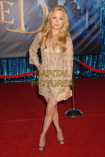 "MARISA COUGHLAN.""Enchanted"" Los Angeles Premiere at the El Capitan Theatre, Hollywood, California, USA..November 17th, 2007.full length beige lace dress clutch bag purse gold hand on hip .CAP/ADM/BP.©Byron Purvis/AdMedia/Capital Pictures."