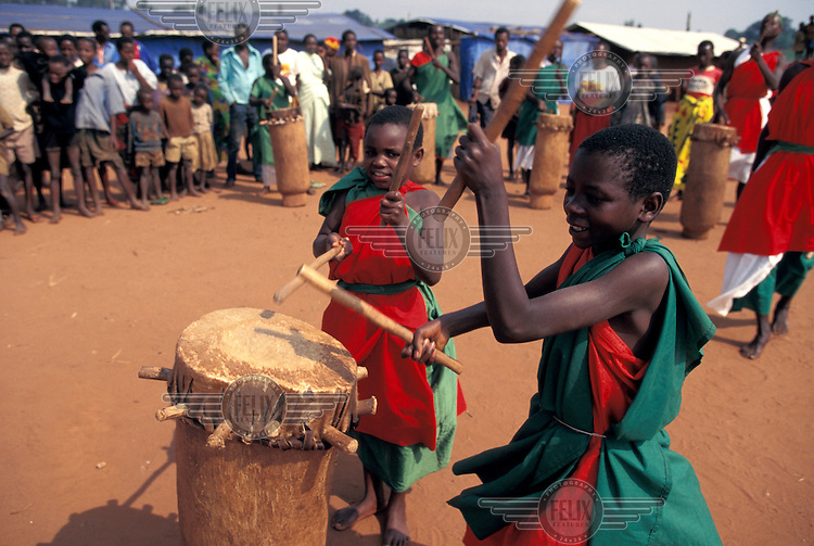 Gitega drummers performing in a camp for internally displaced people (IDPs).