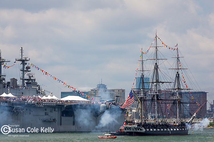 The USS Constitution salutes the USS Wasp in Boston, Massachusetts, USA