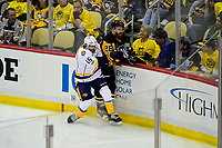 May 29, 2017: Nashville Predators center Craig Smith (15) checks Pittsburgh Penguins defenseman Ian Cole (28) during game one of the National Hockey League Stanley Cup Finals between the Nashville Predators  and the Pittsburgh Penguins, held at PPG Paints Arena, in Pittsburgh, PA. Pittsburgh defeats Nashville 5-3 in regulation time.  Eric Canha/CSM