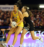 15.09.2013 Silver Ferns Irene Van Dyk and Australian Diamonds Rebecca Bulley in action during the Silver Ferns V Australian Diamonds New World Netball Series played at SIT Zero Fees Velodrome in Invercargill. Mandatory Photo Credit ©Michael Bradley.