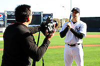 February 25, 2010:  Mark Teixeira of the New York Yankees during listens to instruction from photographer Tom DiPace during photo day at Legends Field in Tampa, FL.  Photo By Mike Janes/Four Seam Images