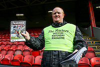 Matchday Programme seller during the Sky Bet League 2 match between Grimsby Town and Wycombe Wanderers at Blundell Park, Cleethorpes, England on 4 March 2017. Photo by Andy Rowland / PRiME Media Images.