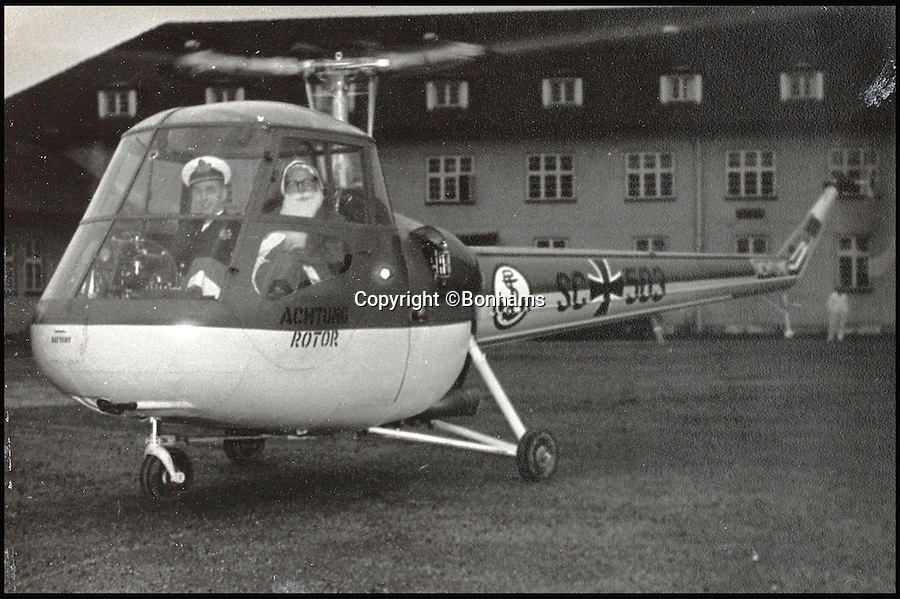 BNPS.co.uk (01202 558833)<br /> Pic: Bonhams/BNPS<br /> <br /> Capt Eric Brown flying a Dragonfly 3 helicopter with Father Christmas as passenger in 1954.<br /> <br /> The historic medals and logbooks of legendary test pilot Eric 'Winkle' Brown have been saved for the nation and will be displayed in a British museum.<br /> <br /> A deal has been secured for the hero's prestigious decorations and all his flying journals after they failed to sell at auction earlier this week.<br /> <br /> They had been expected to sell for &pound;200,000, possibly to an overseas buyer, but bidding only reached &pound;140,000, falling short of the reserve price.<br /> <br /> Now it has emerged that the National Museum of the Royal Navy has negotiated a deal with Captain Brown's family to buy his stunning archive.