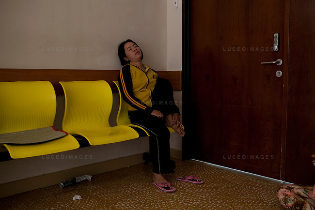 Thang's mother, Tuyet, 31, waits to hear the outcome of her son's heart surgery in Ho Chi Minh City, Vietnam...---..Nguyen Van Thang is nine-years-old and just finished second grade. He lives in the coastal town of Nha Trang with his mother, grandmother, and 10-month-old brother. Thang's father, Bui Van Tri, spends much of his time away from his family, as he is a fisherman and works up and down the coastline. His income is about 400,000VND (~$23USD) per month; however, this salary is seasonal and there are months when he earns nothing at all. ..Thang's mother, Nguyen Thi Bach Tuyet, is 31-years-old and is a housewife. She cannot work as she must look after Thang, his brother, and his grandmother. Therefore, the family of five is solely dependent on Thang's father's income. The family lives in a lean-to extension of Thang's uncle's house that is just eight square meters with a tin roof, cement floor, and brick walls...Thang suffers from Ventricular Septal Defect (VSD), a common congenital heart defect (CHD) that occurs when there is a hole in the wall between the right and left ventricles of the heart. Symptoms of VSD include shortness of breath, fast heartbeats, loss of appetite, poor weight gain, chest pain, and discolored blue skin. In addition, other areas of the child's development such as physical growth and brain development are affected if VSD is left untreated, and the child also has a high chance of developing irreversible pulmonary hypertension...Thang was diagnosed with VSD when he was just two-months-old. He and Tuyet, his mother, made the arduous 10-hour trek from Nha Trang to the Heart Institute in Ho Chi Minh City at least five times over the course of his life, and the diagnosis was always the same: Surgery, or else he would die. Lifesaving surgery, however, was out of the question as it cost $3,100USD--a sum that was beyond anything Thang's family could scrape together. After each hospital visit Tuyet would make the long bus journey back to Nha Tra
