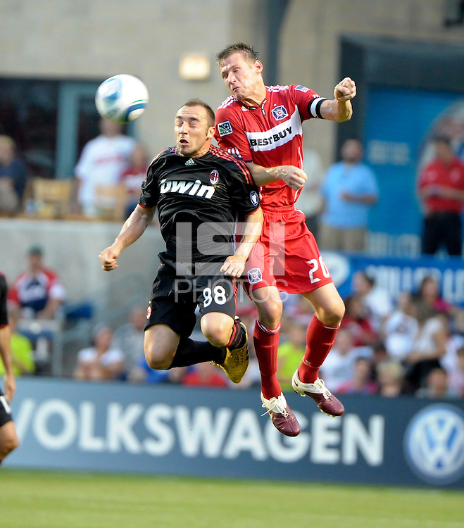 AC Milan midfielder Cristian Brocci (88) battles for a header with Chicago Fire forward Brian McBride (20).  AC Milan defeated the Chicago Fire 1-0 at Toyota Park in Bridgeview, IL on May 30, 2010.