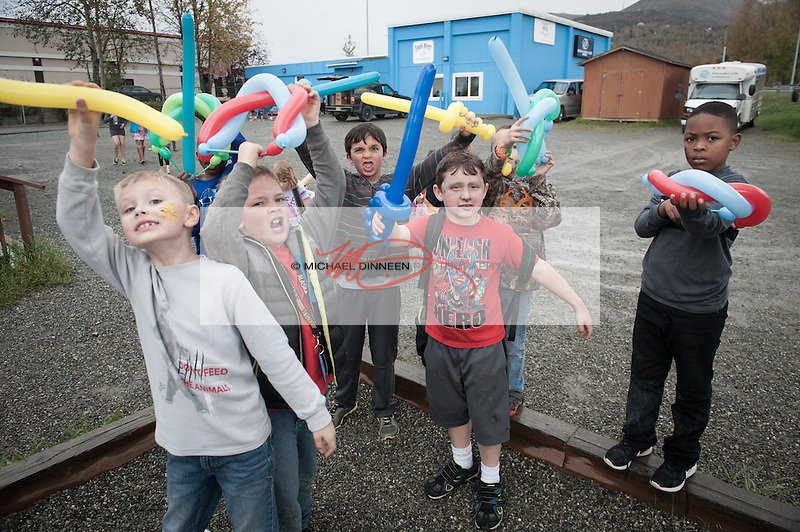 A group of a balloon warriors show off their wares at the Eagle River Boys and Girls Club World Wide Day of Play celebration Friday afternoon.  Photo for the Star by Michael Dinneen