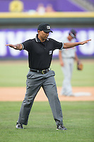 Umpire Erich Bacchus makes a safe call during the Carolina League game between the Salem Red Sox and the Winston-Salem Dash at BB&T Ballpark on May 31, 2015 in Winston-Salem, North Carolina.  The Red Sox defeated the Dash 6-5.  (Brian Westerholt/Four Seam Images)