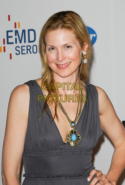 KELLY RUTHERFORD.The 17th Annual Race to Erase MS at the Hyatt Regency Century Plaza Hotel in Century City, California, USA, .May 7th, 2010.half length grey gray dress hand on hip gold necklace clutch bag sleeveless no make-up natural turquoise.CAP/ROT.©Lee Roth/Capital Pictures
