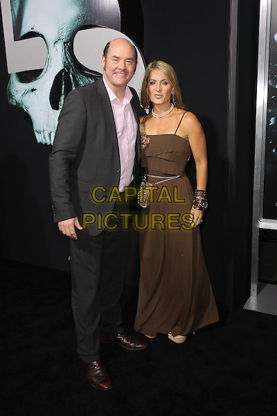 "DAVID KOECHNER & LEIGH KOECHNER.Los Angeles special screening of New Line Cinema's ""Final Destination 5"" at Grauman's Chinese Theatre. Hollywood, CA USA. .August 10th, 2011.full length brown dress black suit married husband wife .CAP/CEL.©CelPh/Capital Pictures."