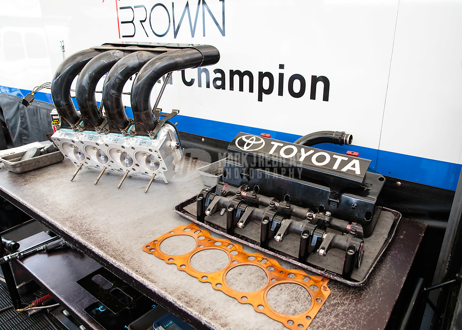 Jul 20, 2018; Morrison, CO, USA; Detailed view of the cylinder heads, header pipes and gaskets on the engine of the dragster of NHRA top fuel driver Antron Brown during qualifying for the Mile High Nationals at Bandimere Speedway. Mandatory Credit: Mark J. Rebilas-USA TODAY Sports