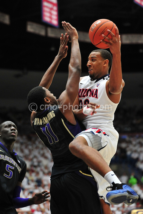 Feb 19, 2011; Tucson, AZ, USA; Arizona Wildcats forward Derrick Williams (23) passes the ball after drawing contact from Washington Huskies forward Matthew Bryan-Amaning (11) in the 1st half of a game at the McKale Center.