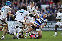 Anthony Watson of Bath Rugby is tackled to ground. Aviva Premiership match, between Bath Rugby and Wasps on January 10, 2015 at the Recreation Ground in Bath, England. Photo by: Patrick Khachfe / Onside Images