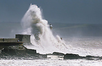 WEATHER PICTURE WALES<br /> Pictured: Waves crashing against the harbour wall and lighthouse in Porthcawl, Wales, UK. Monday 11 September 2017<br /> Re: A yellow &quot;be aware&quot; weather warning of very strong winds has been issued across south and west Wales The Met Office HAS warned.<br /> Gusts could reach 50 mph inland and 60 mph along the coast.