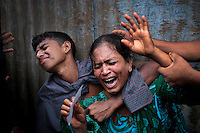 Bangladeshi woman Munni, whose daughters are missing, cries as rescuers search the River Padma after a passenger ferry capsized in Munshiganj district, Bangladesh.