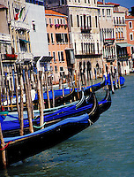The gondolas of Venice, Italy await the next passengers. boat, boats, transportation, cityscape, waterways. Venice, Italy.