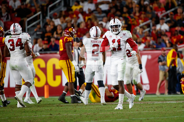 LOS ANGELES, CA - SEPTEMBER 8: Stanford Cardinal cornerback Paulson Adebo #11 celebrates after a quarterback sack during a game between USC and Stanford Football at Los Angeles Memorial Coliseum on September 7, 2019 in Los Angeles, California.