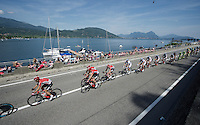 Team Lotto-Soudal in the peloton alongside Lago Maggiore<br /> <br /> Giro d'Italia 2015<br /> stage 18: Melide (SUI) - Verbania (170km)
