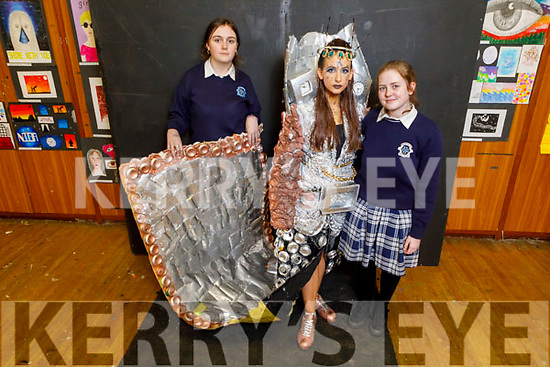 Presentation Castleisland student Leah Pidgeon (Model) with the Creation Stuck in Time with creators Maggie O'Callaghan and Saoirse McCarthy display their Junk Kouture creations at the Presentation Castleisland school on Friday