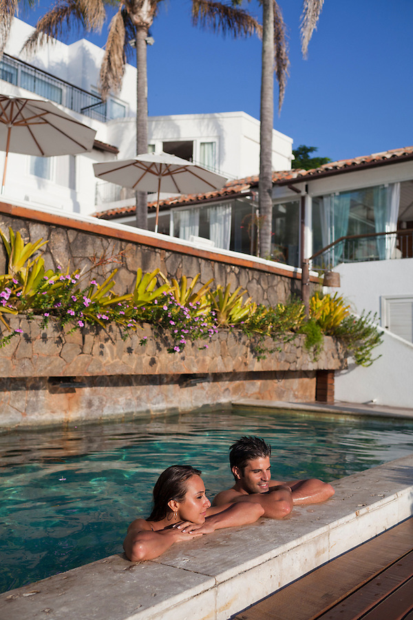 Newlyweds enjoy the pool at Casa Brancas Boutique Hotel and Spa, in Buzios.