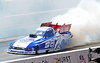 Apr. 5, 2009; Las Vegas, NV, USA: NHRA funny car driver Robert Hight does a burnout during eliminations of the Summitracing.com Nationals at The Strip in Las Vegas. Mandatory Credit: Mark J. Rebilas-