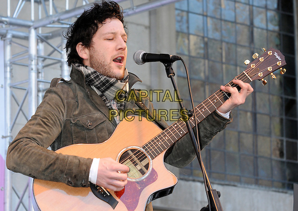 Matt Cardle.BBC Children In Need's Pudsey Street -photocall, New Piazza, Covent Garden, London, England..3rd November 2012.on stage in concert live gig performance performing music half length    grey gray guitar jacket white scarf plaid tartan stubble facial hair singing profile.CAP/PP/BK.©Bob Kent/PP/Capital Pictures