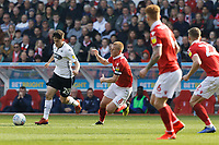 Daniel James of Swansea City (L) is fllowed by Ben Watson of Nottingham Forest during the Sky Bet Championship match between Nottingham Forest and Swansea City at City Ground, Nottingham, England, UK. Saturday 30 March 2019