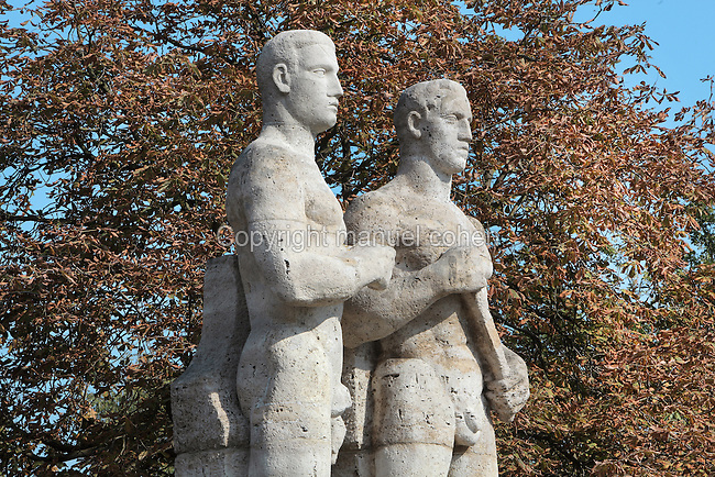 Relay Runners statue, 1935-37, by Karl Albiker, outside the Olympiastadion on the Reichssportfeld, now Olympiapark Berlin, Berlin, Germany. Picture by Manuel Cohen