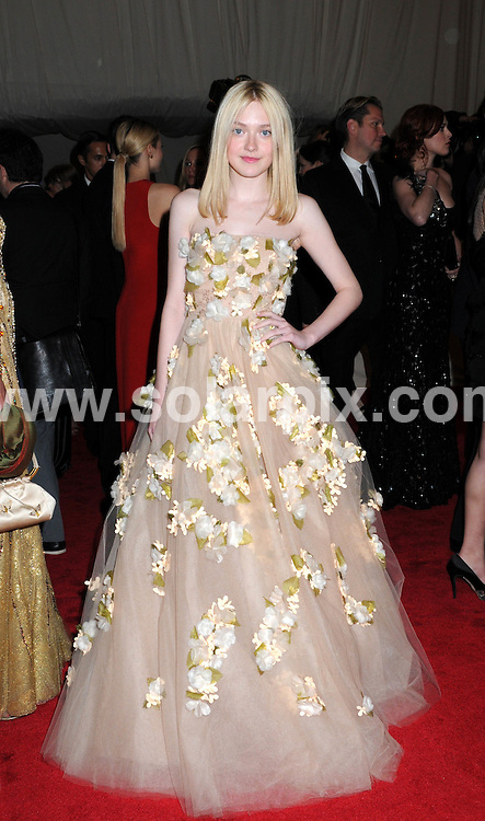 """**ALL ROUND PICTURES FROM SOLARPIX.COM**                                             **SYNDICATION RIGHTS FOR UK, AUSTRALIA, DENMARK, PORTUGAL, S. AFRICA, SPAIN & DUBAI (U.A.E) & ASIA (EXCLUDING JAPAN) ONLY**                                                                                  Caption:  """"Alexander McQueen: Savage Beauty"""" Costume Institute Gala at the Metropolitan Museum of Art  Arrivals The Metropolitan Museum of Art New York City, NY, USA                                                                             This pic:  Dakota Fanning                                                                                            JOB REF:13262        PHZ       DATE: 02.05.2011                                                           **MUST CREDIT SOLARPIX.COM OR DOUBLE FEE WILL BE CHARGED**                                                                      **MUST AGREE FEE BEFORE ONLINE USAGE**                               **CALL US ON: +34 952 811 768 or LOW RATE FROM UK 0844 617 7637**"""