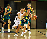 Ferns guard Susie Bates chases Alicia Poto down the court during the International women's basketball match between NZ Tall Ferns and Australian Opals at Te Rauparaha Stadium, Porirua, Wellington, New Zealand on Monday 31 August 2009. Photo: Dave Lintott / lintottphoto.co.nz