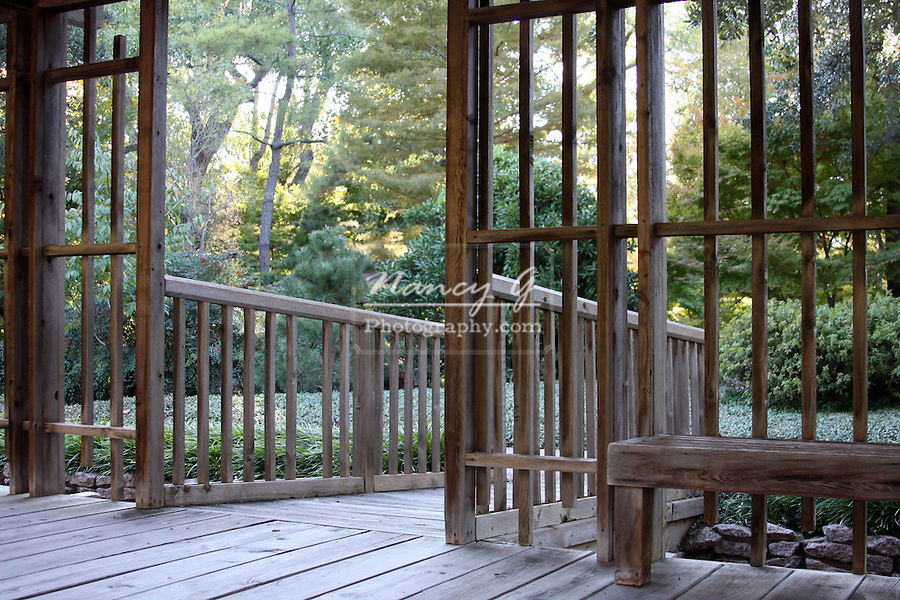 Elaborate deck and railing structure surrounding the Karesansui or dry stone landscape at the Forth Worth Botanic Japanese Garden, Texas