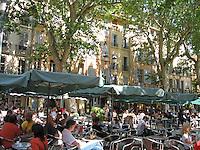 Shady cafes line Aix-en-Provence