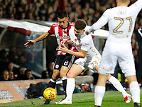 Kalvin Phillips of Leeds United holds off Nico Yennaris of Brentford during the Sky Bet Championship match between Brentford and Leeds United at Griffin Park, London, England on 4 November 2017. Photo by Carlton Myrie.