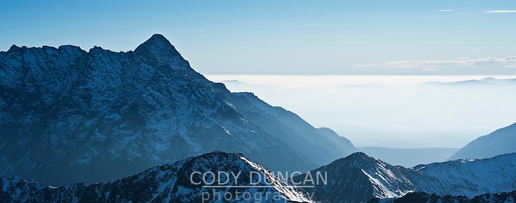 Krivan - 2494 m / 8182 ft rises above valley fog, Tatra Mountains Poland/Slovakia