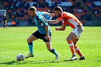 Fleetwood Town's Paddy Madden vies for possession with Blackpool's Clark Robertson<br /> <br /> Photographer Richard Martin-Roberts/CameraSport<br /> <br /> The EFL Sky Bet League One - Blackpool v Fleetwood Town - Saturday 14th April 2018 - Bloomfield Road - Blackpool<br /> <br /> World Copyright &not;&copy; 2018 CameraSport. All rights reserved. 43 Linden Ave. Countesthorpe. Leicester. England. LE8 5PG - Tel: +44 (0) 116 277 4147 - admin@camerasport.com - www.camerasport.com