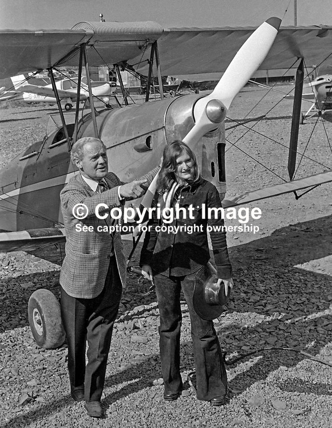 Wartime flying hero Group Captain Douglas Bader, at Newtownards Airfield, N Ireland, to declare open the Ulster Flying Club's new clubhouse pictured in front of a Tiger Moth with club member, Jane Galloway, 20 years, from Holywood, Co Down. 197504750356DB2 .<br />