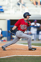 Alex Perez (8) of the Elizabethton Twins follows through on his swing against the Kingsport Mets at Hunter Wright Stadium on July 9, 2015 in Kingsport, Tennessee.  The Twins defeated the Mets 9-7 in 11 innings. (Brian Westerholt/Four Seam Images)
