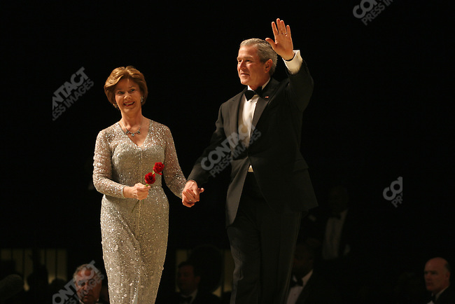 55th Presidential Inauguration: George W Bush and his wife Laura at the Patriot Ball, Washington D.C., USA. January 20, 2005.
