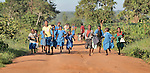 Children hurry to school along a rural road near Kanyemba, in northern Malawi.