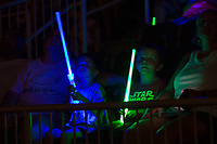 Two young fans watch the post-game fireworks while holding their light sabers on Star Wars Night following the South Atlantic League game between the Columbia Fireflies and the Kannapolis Intimidators at Kannapolis Intimidators Stadium on July 22, 2017 in Kannapolis, North Carolina.  The Fireflies defeated the Intimidators 4-0.  (Brian Westerholt/Four Seam Images)