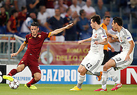 Calcio, Champions League, Gruppo E: Roma vs CSKA Mosca. Roma, stadio Olimpico, 17 settembre 2014.<br /> Roma midfielder Alessandro Florenzi, left, is challenged by CSKA Moskva defender Georgi Schennikov, center, and midfielder Georgi Milanov, of Bulgaria, during the Group E Champions League football match between AS Roma and CSKA Moskva at Rome's Olympic stadium, 17 September 2014.<br /> UPDATE IMAGES PRESS/Riccardo De Luca