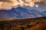 Dramatic sunset lights up Chugach Mountains, viewed from Glenn Hwy, Southcentral Alaska, Autumn.